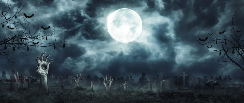 Zombie Rising and hands Out Of A Graveyard cemetery scary In Spooky dark Night full moon. Holiday event halloween concept.
