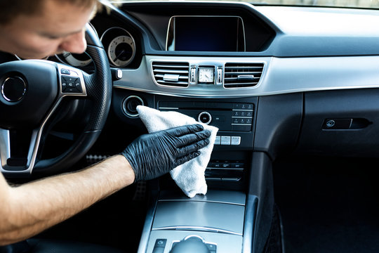 Cleaning the car, cleaning the interior of the car with a microfiber cloth