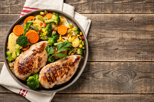 Grilled chicken breasts with vegetable