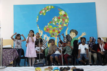 Libyan students sing during rehearsal as they attend the summer school programme at a local school in Tripoli