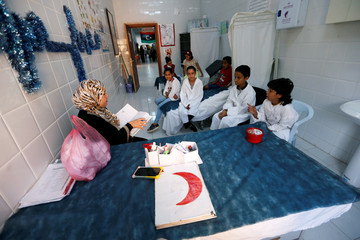 Libyan students attend a first aid class during the summer school programme At al-Jihad primary school in the Sooq Juma municipality, in Tripoli