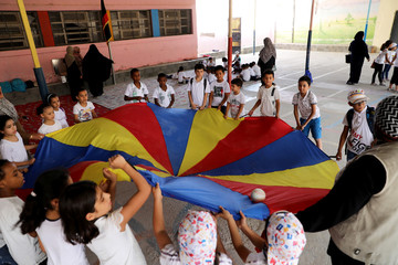Libyan students play during the summer school programme at Ben Ashour school in Tripoli