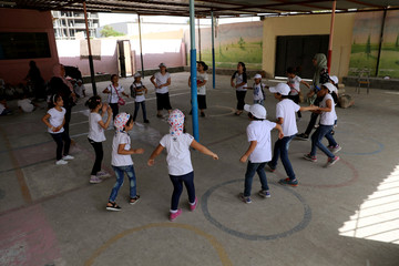 Libyan students play at the yard of a school during the summer school programme at Ben Ashour school in Tripoli
