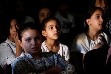 Libyan students attend a class during the summer school programme at a local school in Tripoli