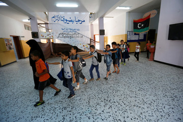 Libyan students are seen during summer school programme at a local school in Tripoli