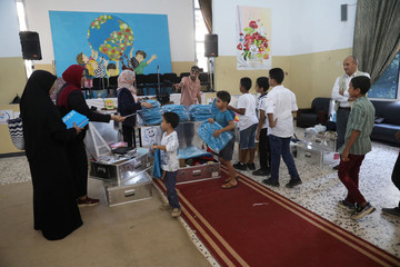 Libyan students receive school supplies provided by Unicef during the summer school programme at a local school in Tripoli