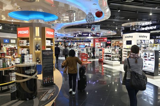 BRUSSELS, BELGIUM - NOVEMBER 20, 2016: Passengers visit duty free shops at Brussels Zaventem Airport in Belgium. It was 21st busiest airport in Europe in 2015 with 23 million passengers.
