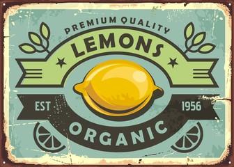 Premium quality organic lemons vintage sign. Lemons retro poster. Old sign with fresh yellow lemon and decorative ribbons. Fruit vector image.
