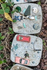 Old toys reused as pavers in the garden.
