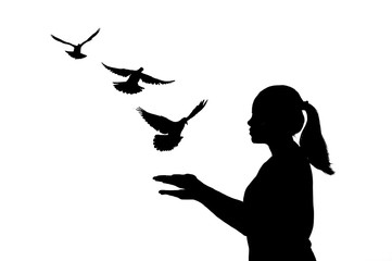 silhouette young women were praying and free bird fly on white background . hope and people concept and international day of peace.