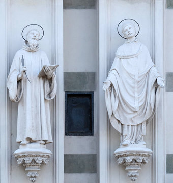 Statues of St. Bernard of Clairvaux and Gregory the Great on the facade of Sacro Cuore del Suffragio church in Rome, Italy
