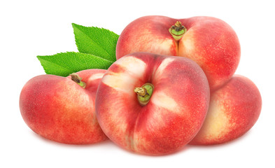 Composition with whole freshly picked flat nectarines with leaves isolated on white background. As design element.