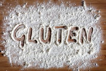 Gluten word written in flour on baking board