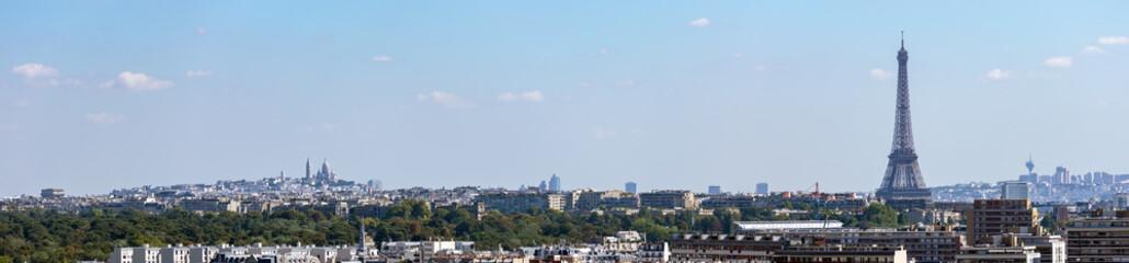 Panoramic skyline of Paris with the Eiffel tower, Montmartre and Arc de Triomphe. Shot from Parc de Saint-Cloud - France.