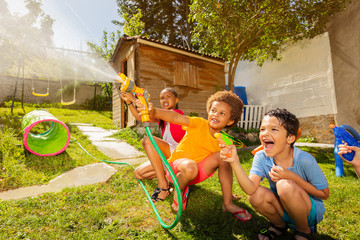 Fun with water guns and garden hose sprinkler
