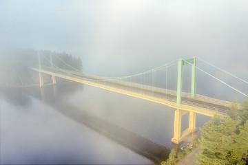 Printed roller blinds Bridge Karisalmi suspension bridge, Paijanne National Park, southern part of Lake Paijanne. Blue lakes, fog, bridge in Finland. Morning foggy landscape.