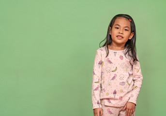 Asian little girl in pajamas