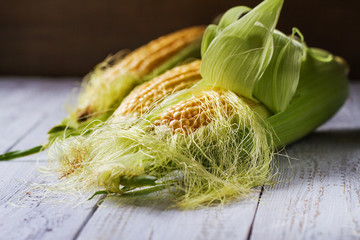 Foto op Plexiglas Spa Corn natural fresh on a wooden background for cooking.