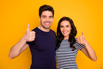 Close-up portrait of his he her she nice attractive lovely cheerful cheery glad content people married spouses showing thumbup isolated over bright vivid shine yellow background