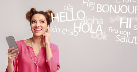 Woman with cellphone hearing different languages on grey