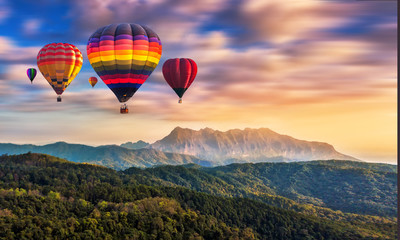 Fotobehang Ballon Colorful hot air balloons flying over Doi Luang Chiang Dao, Chiang Mai in Thailand