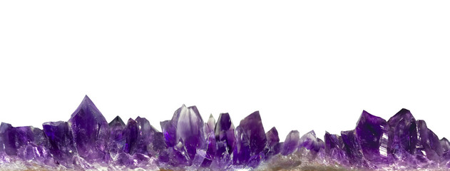 amethyst crystals border on white background