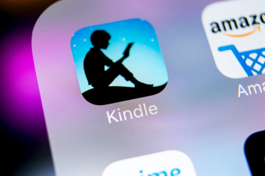 Sankt-Petersburg, Russia, March 7, 2018: Amazon Kindle application icon on Apple iPhone X screen close-up. Amazon Kindle app icon. Amazon kindle application. Social media network