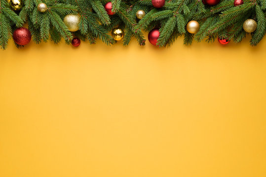Yellow Christmas or New Year decoration background with border