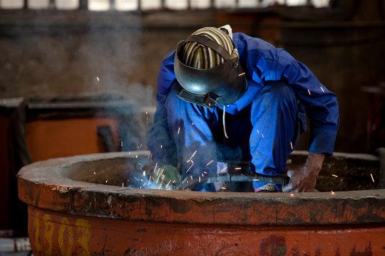 Welding an industrial magnet in a factory, Gauteng, South Africa