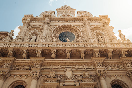 LECCE, ITALY /  SEPTEMBER 2019: The facade of the Basilica of Santa Croce in southern Italy.