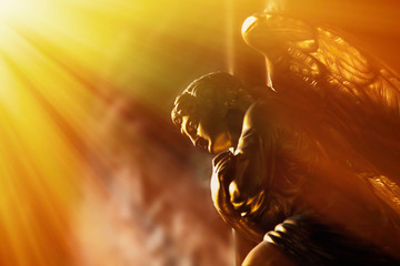 Fotomurales - God's gold angel in the sunlight. Antique statue.