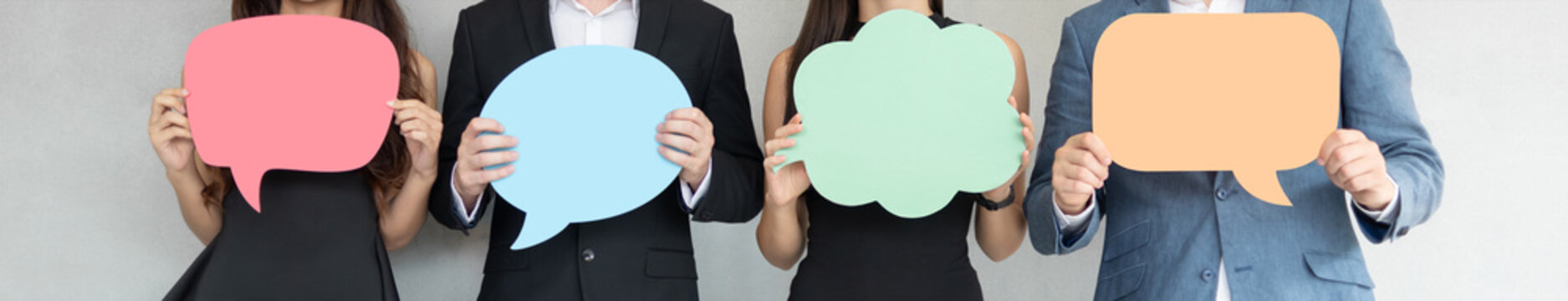People are holding colorful Speech Bubbles.