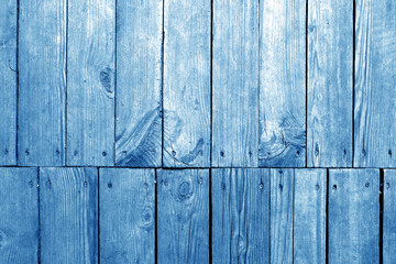 Old grungy wooden planks background in navy blue tone.