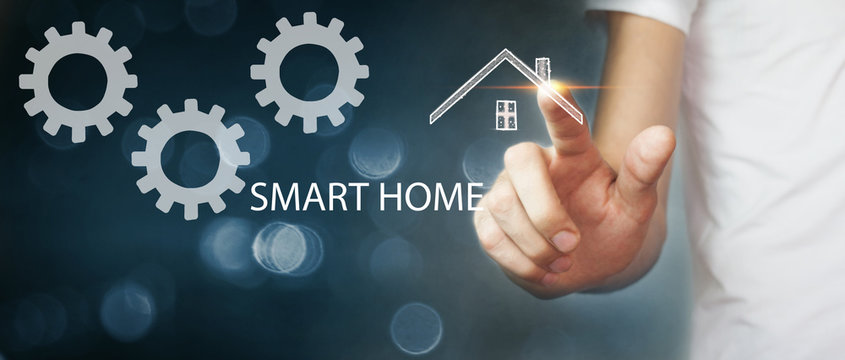 man clicks on the screen to configure smart home settings