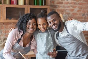 Close sweet family taking selfie at kitchen