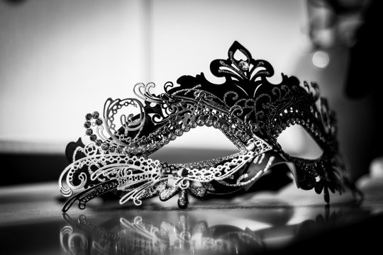 A black and white portrait of a venetian mask to hide your identity on a masquerade ball and shroud yourself in mystery.