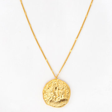 Vintage gold pendant necklace on gold chain, isolated