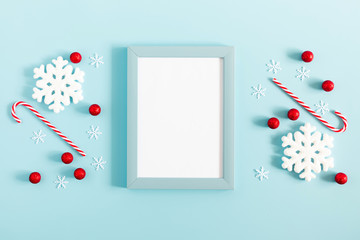 Christmas holiday composition. Xmas white and red decorations on pastel blue background. Christmas, New Year, winter concept. Flat lay, top view, copy space