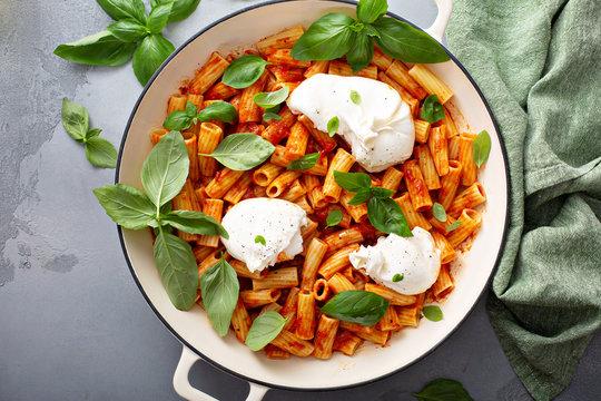 Penne pasta marinara with buratta cheese and fresh basil