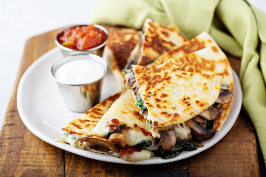 Mushroom and cheese quesadillas with sour cream and tomato salsa