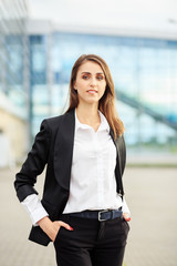 Successful smiling woman in a suit. Concept for business, employees, partners and entrepreneurs.