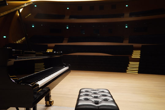 Grand Piano and seat in Concert Hall, close-up.