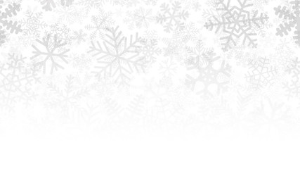 Christmas background of many layers of snowflakes of different shapes, sizes and transparency. Gradient from gray to white