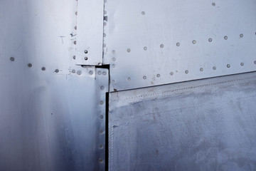 Close up of rivets aluminium. Aircraft fuselage and wing