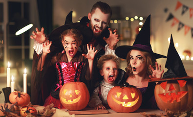 happy family mother father and children in costumes and makeup on  Halloween. Wall mural