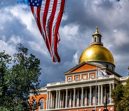 american flag on mass state house