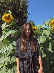 girl in the village near sunflowers