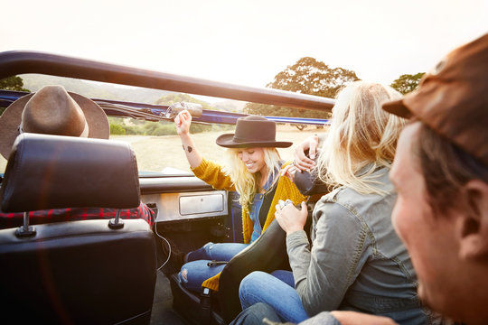 Woman dancing to music in front seat
