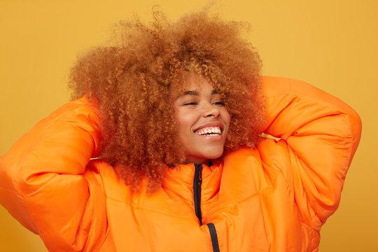 Young woman studio portrait touching hair