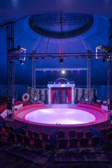 Empty illuminated arena of circus canvas
